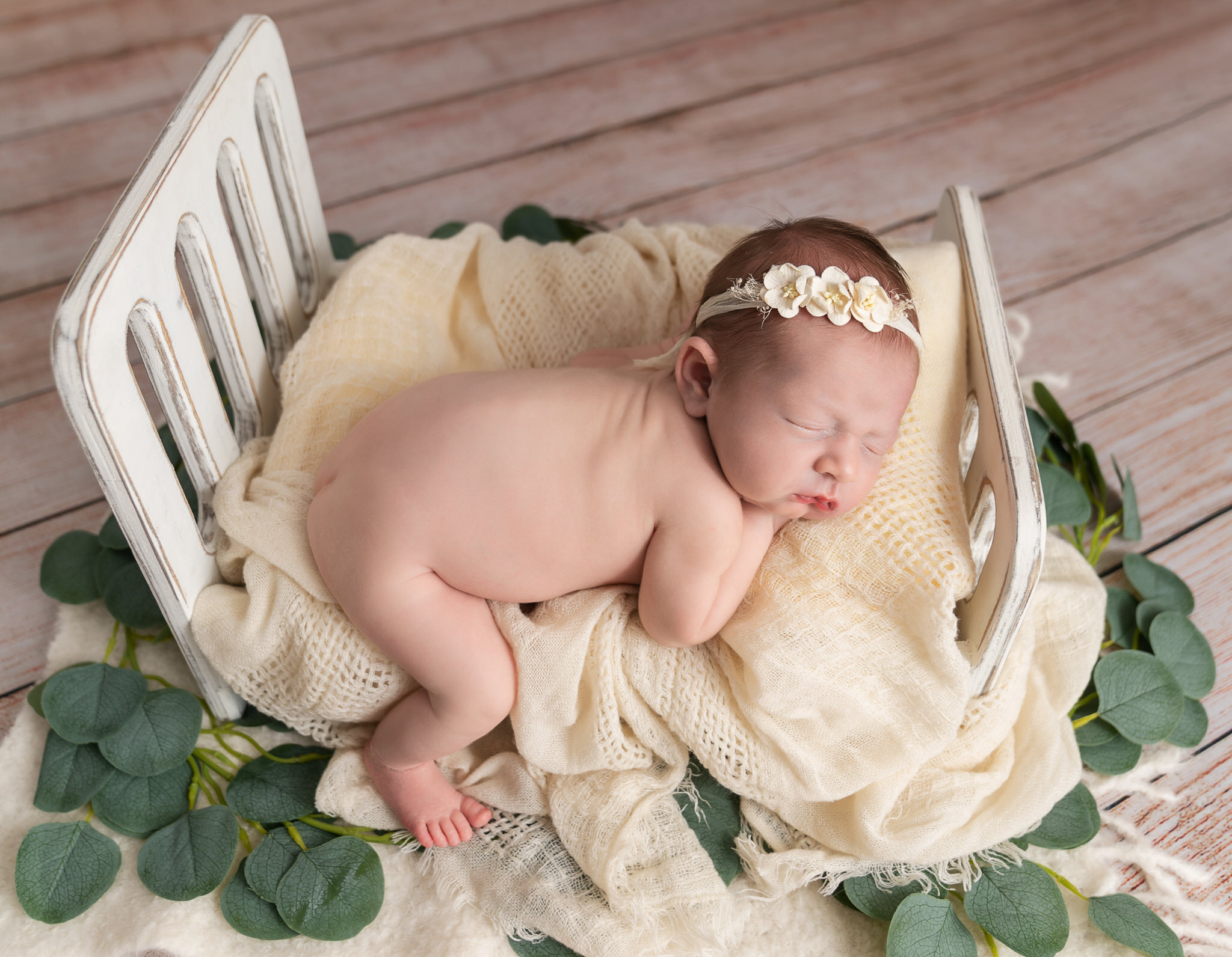 baby girl on bed in studio photoshoot by Newborn Photographer Longfield, Sevenoaks