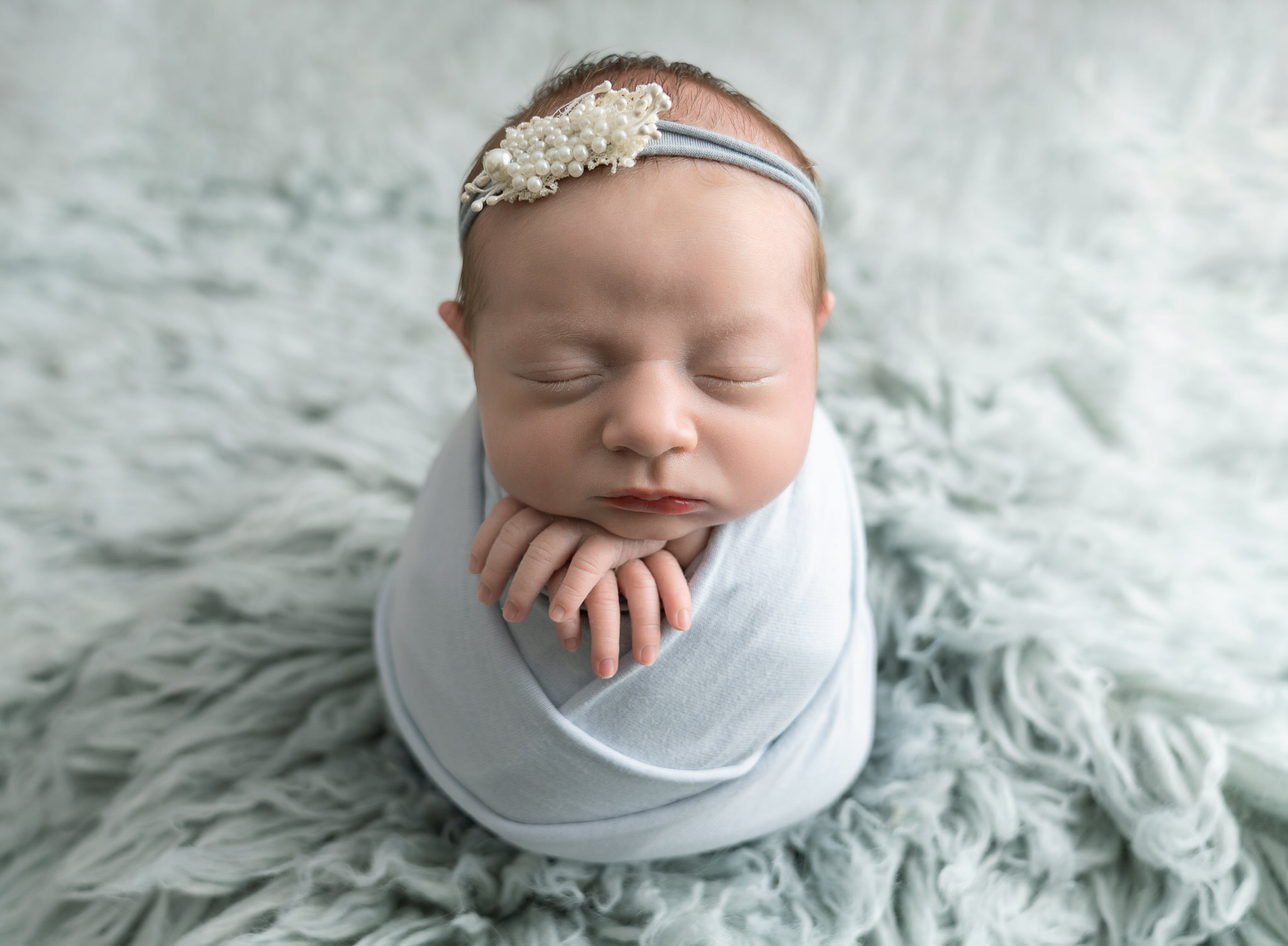 baby girl in blue in newborn phtoshoot by Newborn Photographer Longfield, Sevenoaks