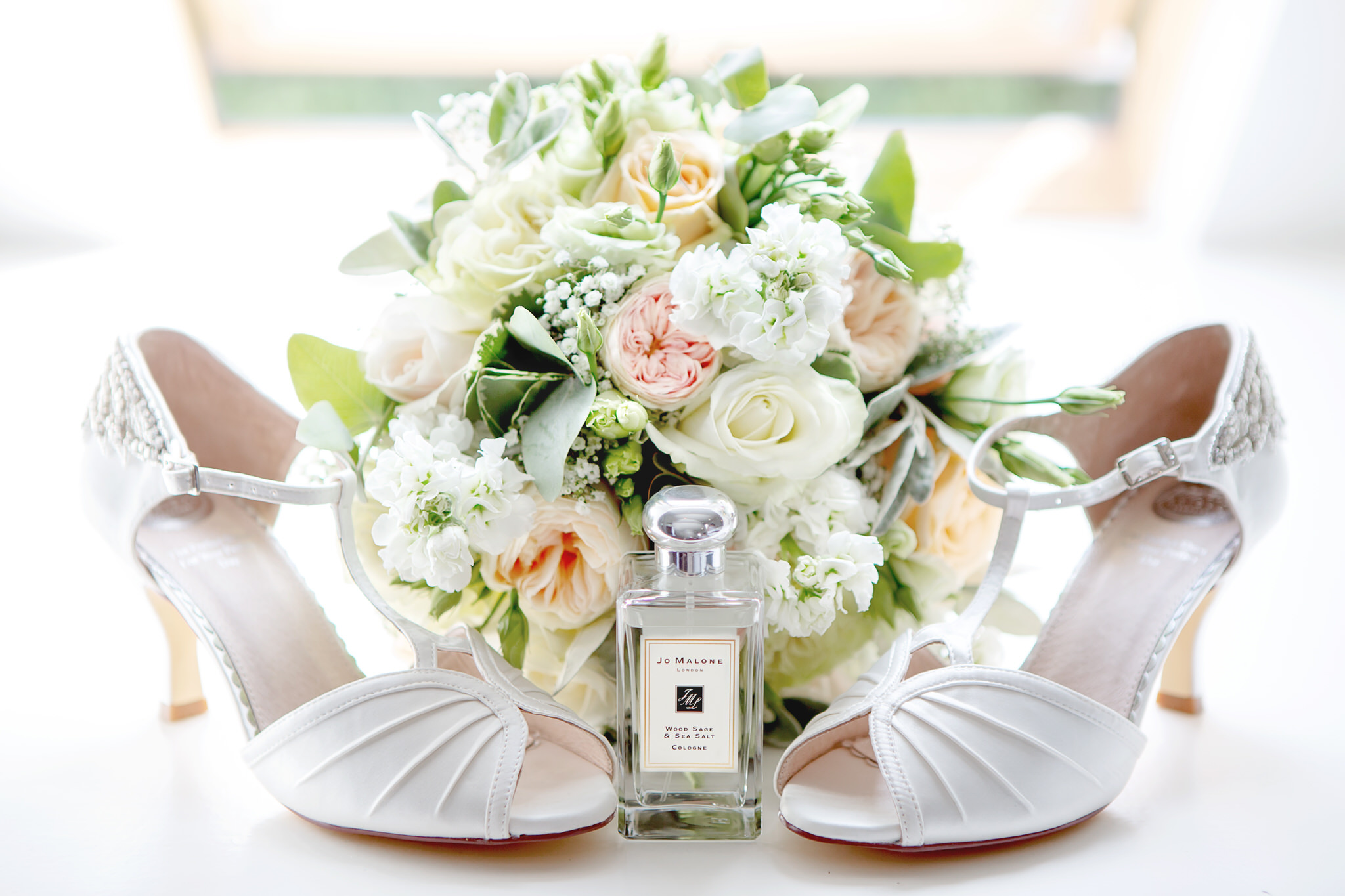 Bridal bouquet and wedding shoes by Kent wedding photographer
